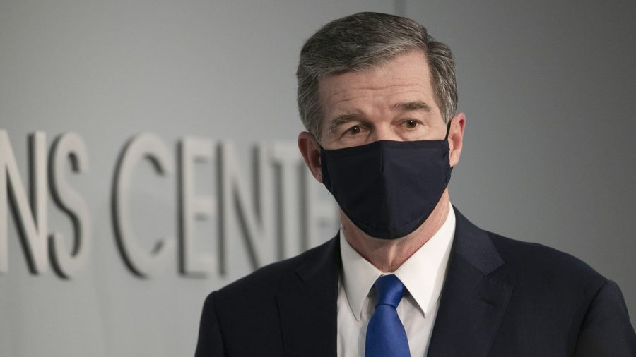 North Carolina Governor Roy Cooper arrives for a press briefing on the COVID-19 virus at the Emergency Operations Center on Wednesday, June 24, 2020 in Raleigh, N.C.